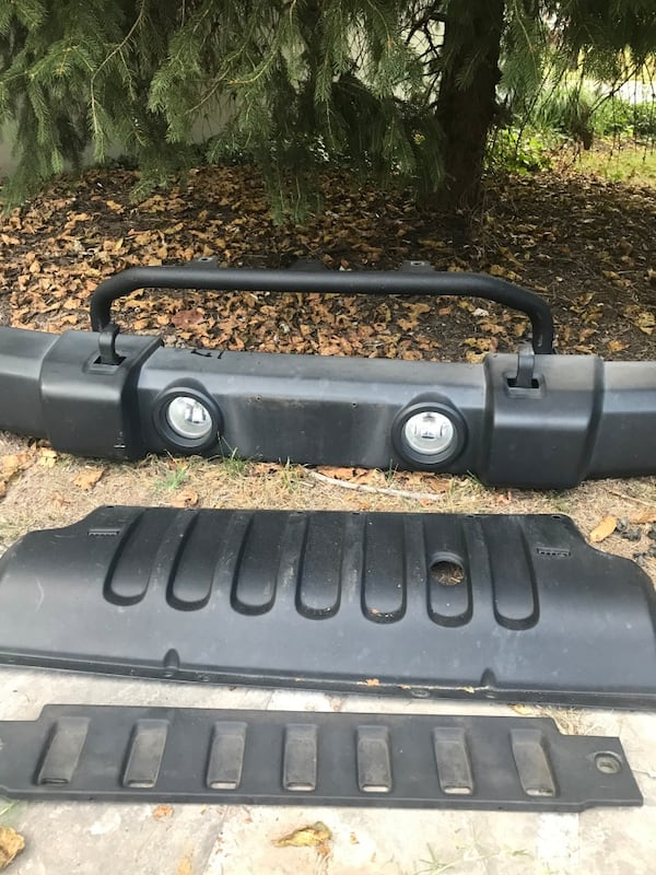 2015 Jeep Wrangler JK OEM front bumper; includes skid plate and valance panel 45465adf-efe0-4ad7-9d54-9d3817a75558
