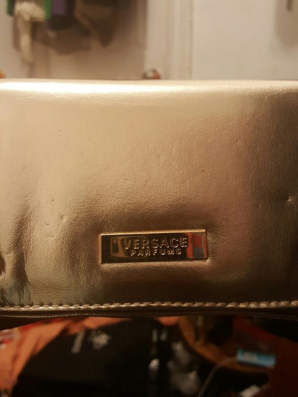 Used Versace Parfums bag in Gold for sale in New York - letgo cc8e4b10989e6