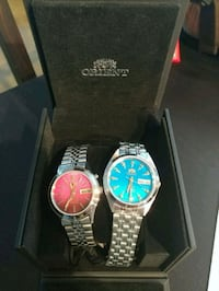 two round silver analog watches with link bracelet 3126 km