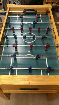 brown and green foosball table 60 km