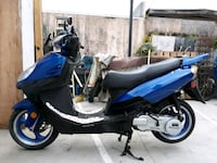 blue and black motor scooter Los Angeles, 90044