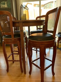 Solid wood bar table and 4 leather swivel stools