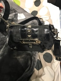 monogrammed black Coach leather crossbody bag