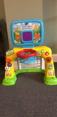toddler's multicolored Vtech Smart Shots Sports Center
