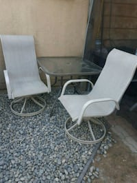 EUC 4 small patio table and 2 swivel chairs Langley Township, V4W 3H7