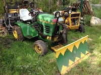 Green and yellow John Deere riding mower Sterling, 06377