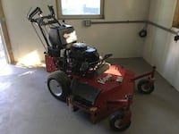 Red and black zero turn mower 27 mi