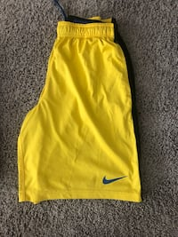women's yellow Nike shorts Austin, 78744