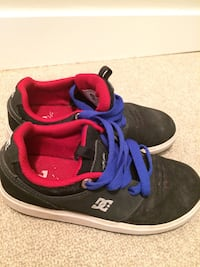 Pair of red and blue DC boys skate shoe Calgary, T2B 1K5