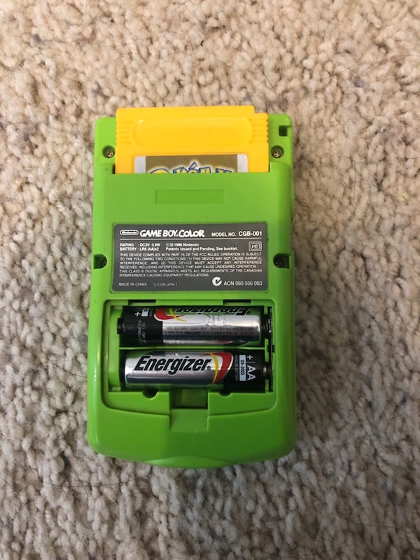 Green Gameboy Color With Pokemon Yellow dba77483-dfa8-49d5-8e32-3d7ef8eb54c4
