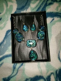 four silver and blue gemstone pendant necklaces