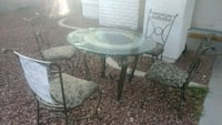 Dinning set glass table & 4 chairs.  2060 mi