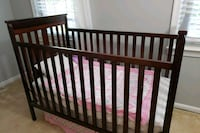 baby's brown wooden crib Nokesville, 20181