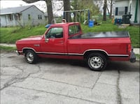 Red single cab pickup truck. It is a short bed and it has  98000 miles on it; runs good. It does have some rust on it, but it is a nice truck and dependable. Seattle
