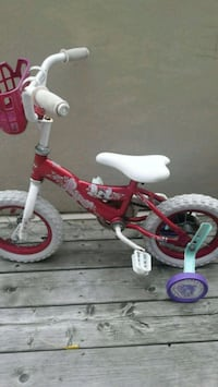 toddler's pink and white bicycle with training wheels 534 km