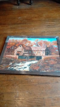 brown wooden framed brown house and water wheel pa