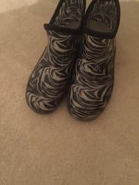 pair of white-and-black rain boots