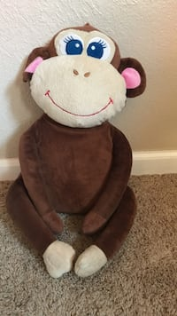 brown and pink monkey plush toy