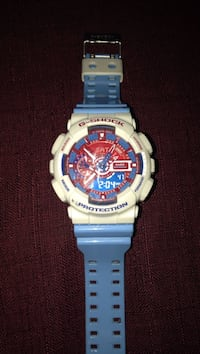 Round white casio g-shock digital watch with blue band Lincoln, L0R