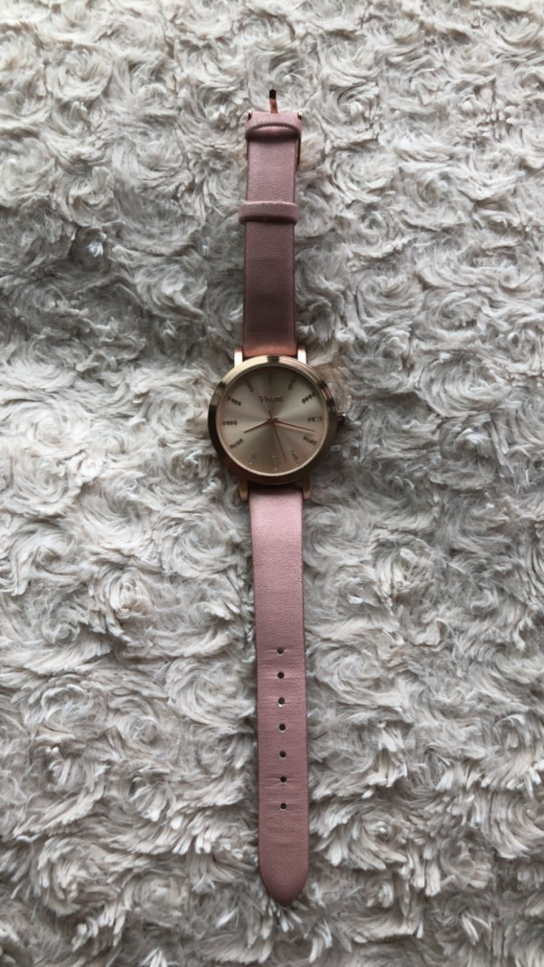 round gold analog watch with gold link bracelet