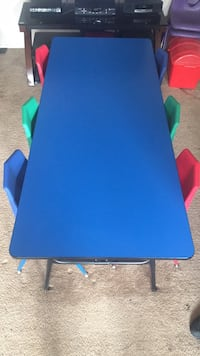 Blue Folding table for older and younger children with six multicolored chairs in excellent condition  Greenbelt