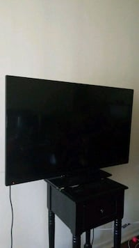 black flat screen TV with remote Melbourne