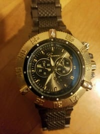 round black chronograph watch with silver link bracelet Toronto, M6N 2M8