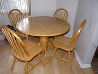 Drop-leaf Pedestal Round Table with 4 chairs - $375