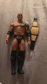 The Rock action figure with wwe belt