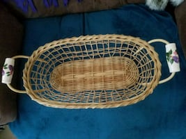 Wicker basket with painted handles