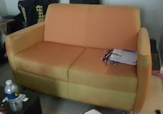 Vintage looking orange 2 seater sofa