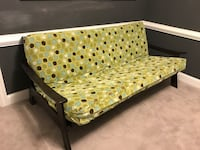 teal, beige, and yellow futon bed