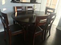 Wooden dining table with 6 chairs the condition is 9 out of 10 Toronto, M1P 0A1