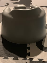 Bumbo floor seat ( selling two one blue and one grey)