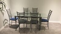 Glass top table with 6 padded chairs