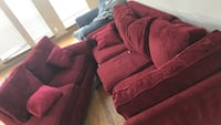 Red suede 3-seat sofa as well as one in the back for free.