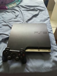 black Sony PS3 slim console with controller Dartmouth, B3A 3L7