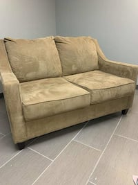 Tan suede two seated couch