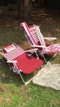 Two white-and-red stripe outdoor chaise lounges