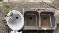 Two white ceramic sink with stainless steel faucets Surrey, V3W