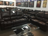 Bonded leather Reclining sofa and love seat. Brand new.  Frisco