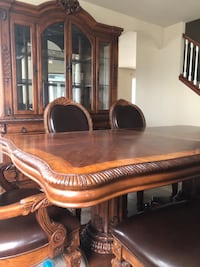 Brown wooden framed glass display cabinet and dining table and chairs Puyallup, 98374