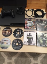 black Sony PS3 game console with game cases Richmond Hill, L4S 2J1