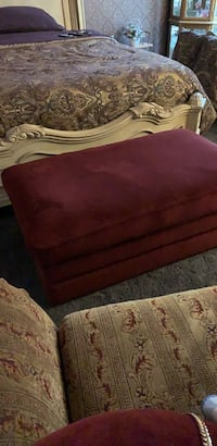 "La-z-boy storage ottoman, burgundy plush. 46"" x 26"" x 17"" high. Interior 40"" x 21"" x x8"" deep. With  easy-glide casters"