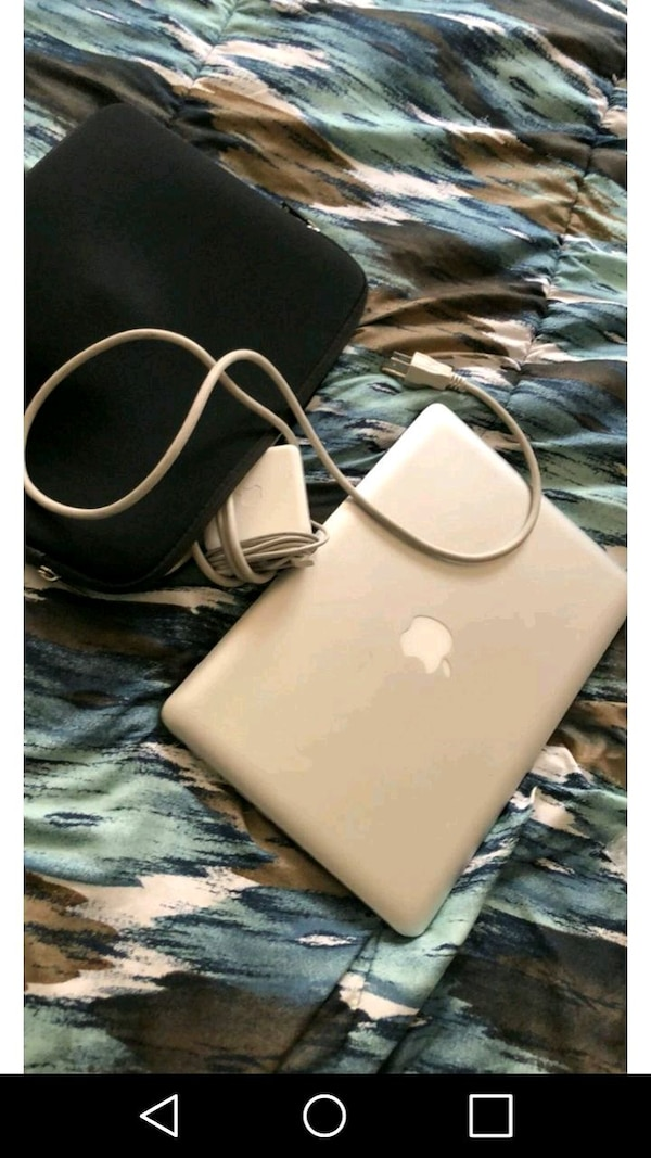 Mac computer with charger unlocked