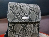 gray and black snakeskin leather bag