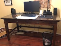 Desk with protective glass top custom cut to fit the top.  Excellent condition and solid wood. Rockville