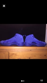 Pair of blue air jordan 12's deep royal blues