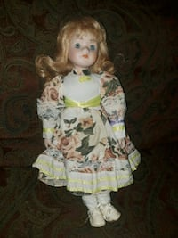 girl doll in white and pink floral dress Magee, 39111