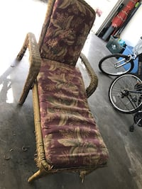 red and brown floral padded armchair